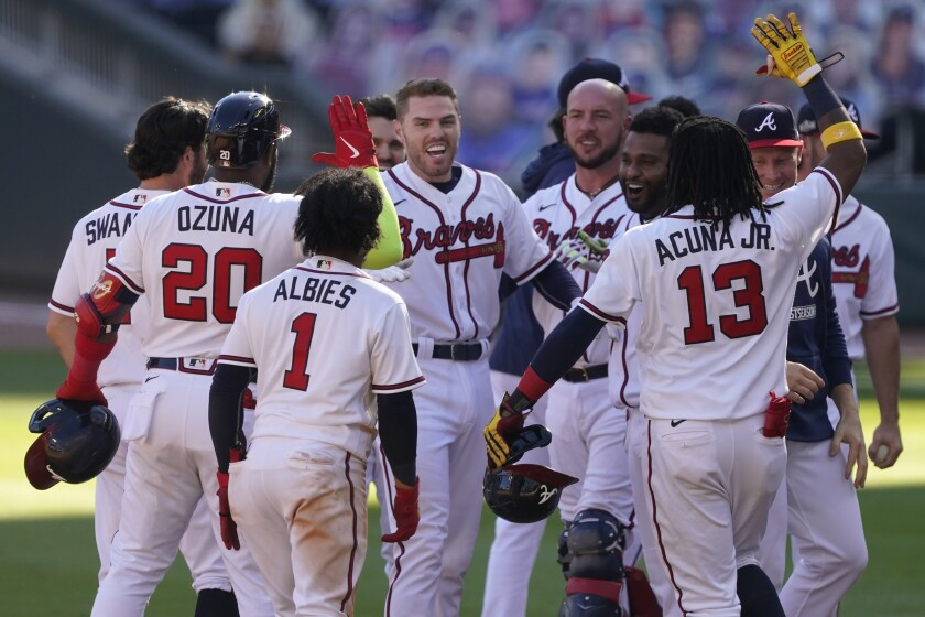 Atlanta Braves Freddie Freeman (5) celebrates driving in the game-winning run against the Cincinnati Reds in the 13th inning during Game 1 of a National League wild-card baseball series, Wednesday, Sept. 30, 2020, in Atlanta. The Atlanta Braves won 1-0. (AP Photo/John Bazemore)