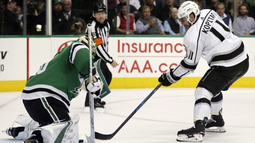 Los Angeles Kings center Anze Kopitar (11), of Slovenia, scores a goal on Dallas Stars goaltender Be