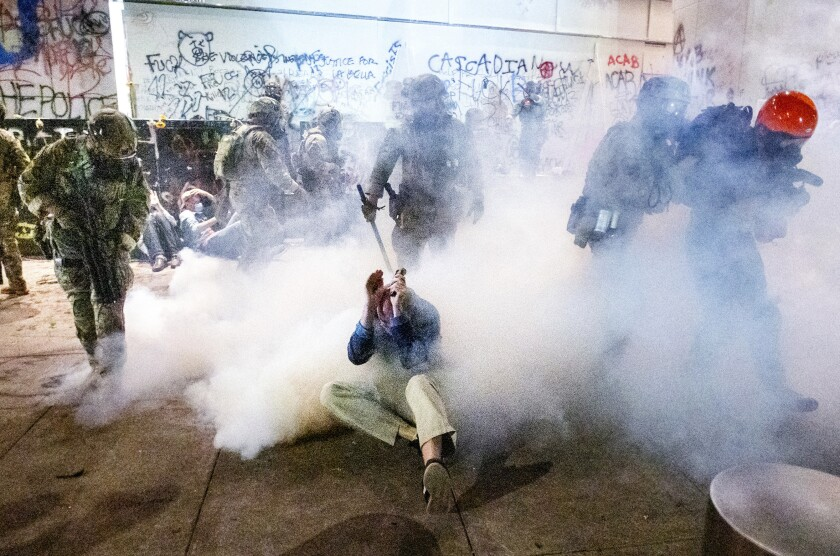 Federal officers use chemical irritants and crowd control munitions to disperse Portland protesters