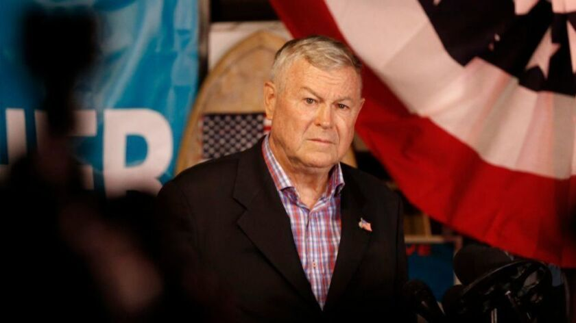 Rep. Dana Rohrabacher addresses reporters and his supporters at an election night party in Costa Mesa on Nov. 6.