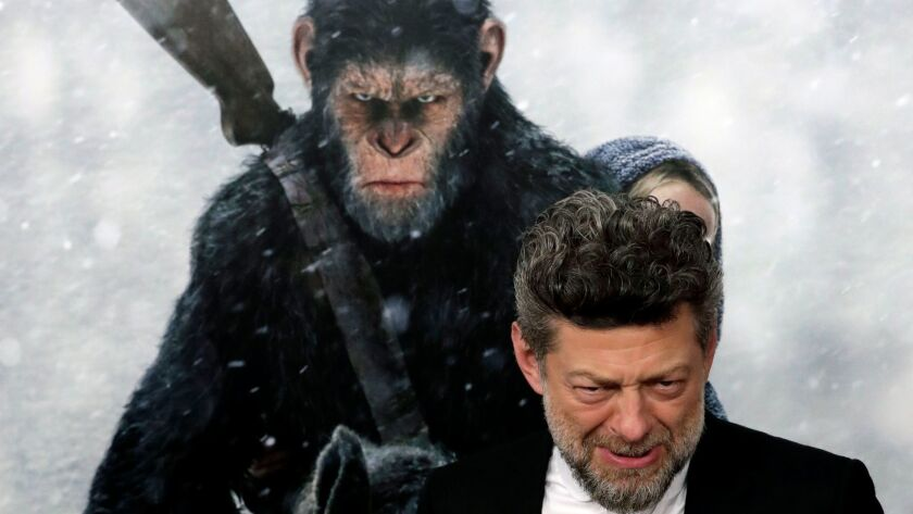 """Andy Serkis, who portrays the eloquent chimpanzee leader Caesar, reacts as he arrives for the """"War f"""