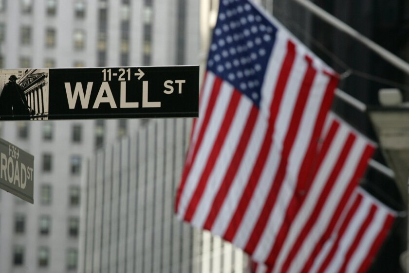 FILE - In this Sept. 17, 2008 file photo, a Wall Street sign is shown in New York.  Stocks are edging mostly lower in early trading on Thursday, Feb. 18, 2016, after several companies posted disappointing quarterly results.  (AP Photo/Mark Lennihan)