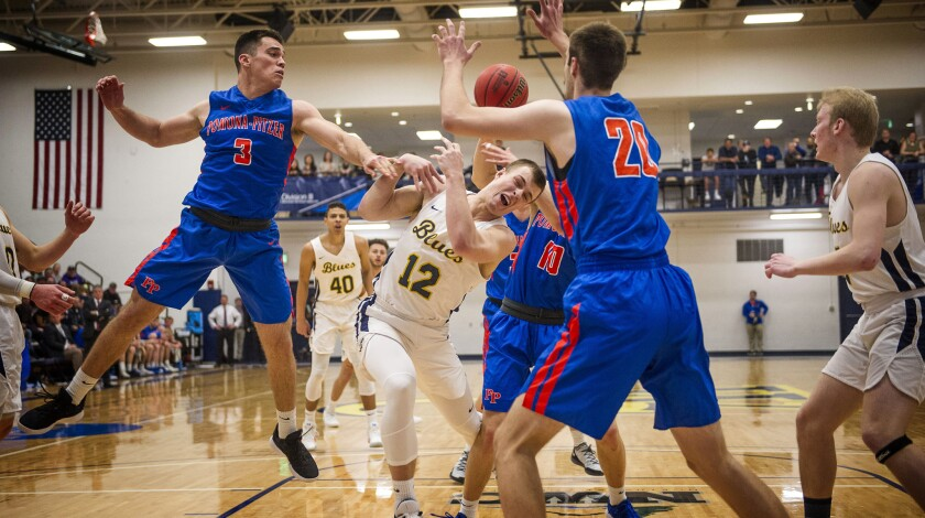 Whitman College's Robert Colson (12) gets caught inside battling for a rebound against Pomona-Pitzer