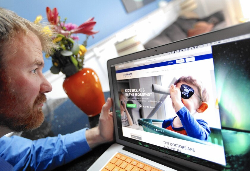 From his home in Hawthorne, Tom Essenpreis looks at a website that offers online video consultation with a doctor. He used such a service when his 2-year-old daughter had what he thought was pinkeye.
