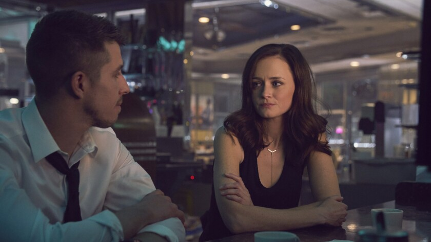 "(L-R)- Beau Knapp and Alexis Bledel in a scene from ""Crypto."" Credit: Lionsgate"