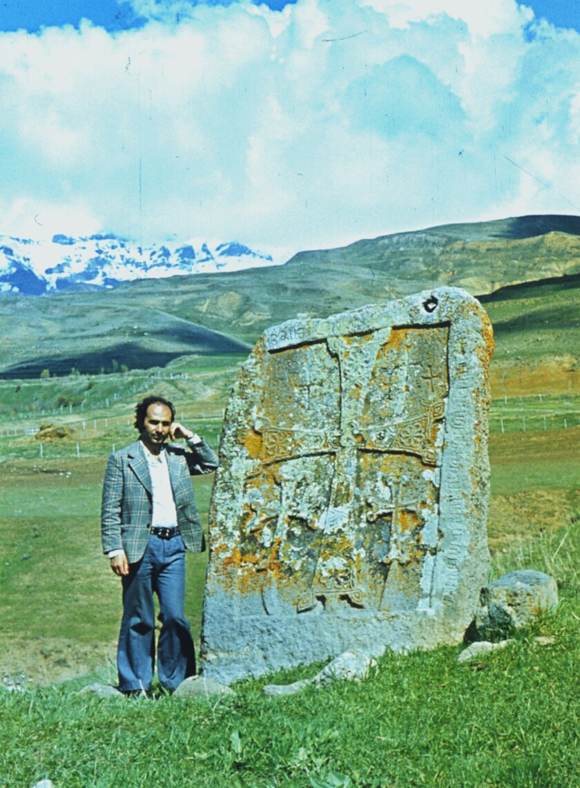 Argam Ayvazyan, a researcher who documented the medieval Armenian monuments of Nakhichevan, pictured by a khachkar.