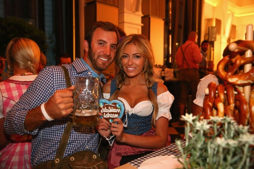 Dustin Johnson and Paulina Gretzky, shown at the BMW International Open 25th anniversary party in Munich this summer, have announced their engagement.