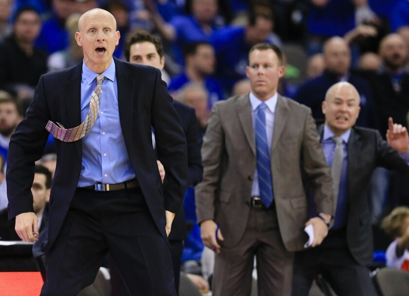 Xavier coach Chris Mack follows the game during the second half of an NCAA college basketball game against Creighton in Omaha, Neb., Tuesday, Feb. 9, 2016. Creighton won 70-56. (AP Photo/Nati Harnik)