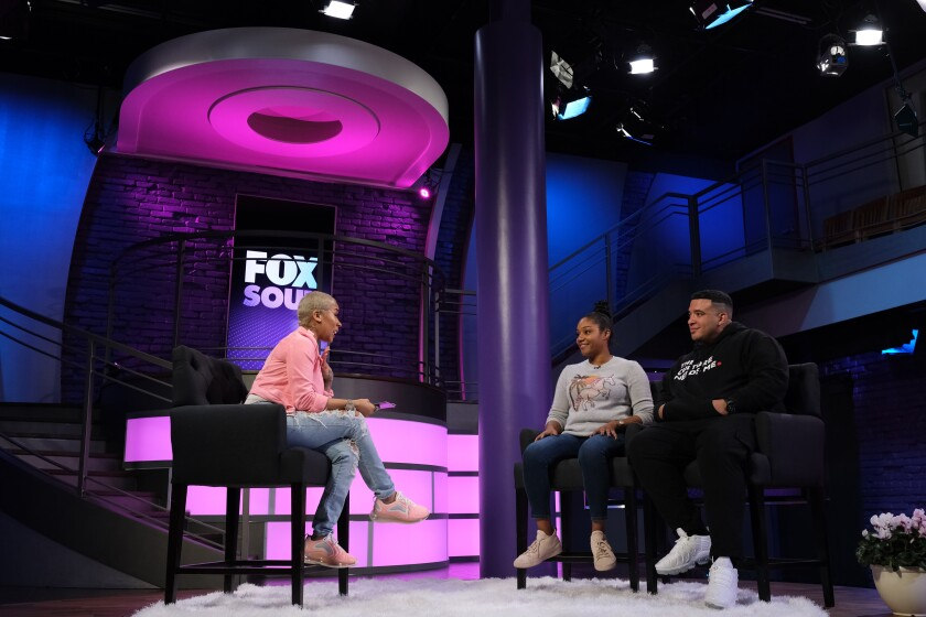 Keyshia Cole interviews Tiffany Haddish and Jason Lee on the set of her show for the streaming service Fox Soul.