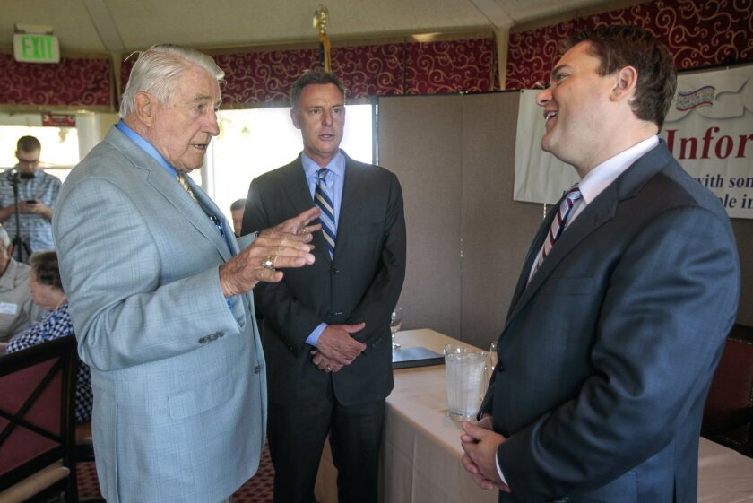 Don Norris, left, who is the President of the Conservative Order for Good Government, talks to Congressman Scott Peters, center, and Carl DeMaio before the two candidates for 52nd Congressional District debate during a COGG meeting at the Bernardo Heights Country Club in Rancho Bernardo.