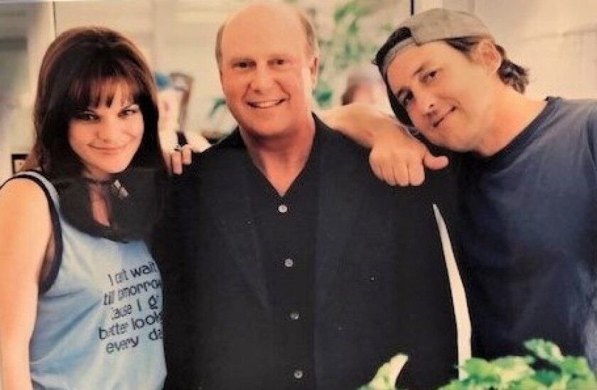 "Cameron Crowe, right, gave Gabriel Wisdom, center, an autographed photo of them with actress Pauley Perette, who played Alice Wisdom, a DJ based on Gabriel's persona in the movie ""Almost Famous,"" released in 2000. Crowe did not include Wisdom in the musical version of the movie, which opens Sept. 27 at The Old Globe."