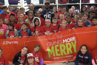 Chargers safety Darrell Stuckey shops with kids from Armed Services YMCA