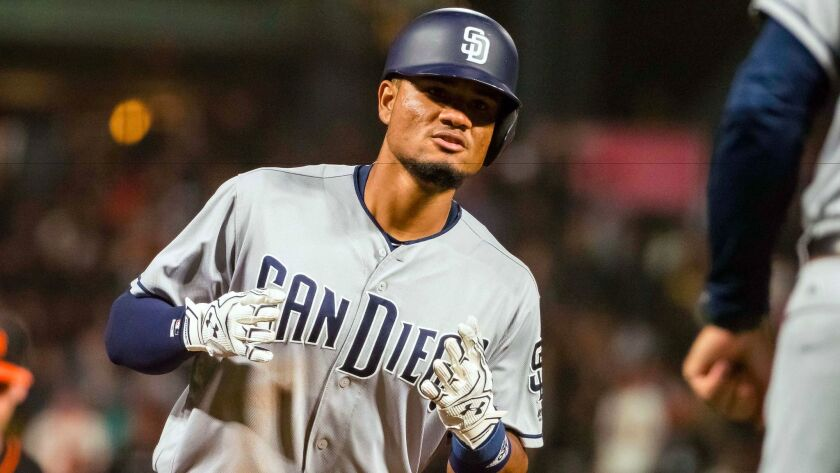 San Diego Padres left fielder Allen Cordoba rounds the bases on a three-run home run against the San Francisco Giants during the seventh inning at AT&T Park.