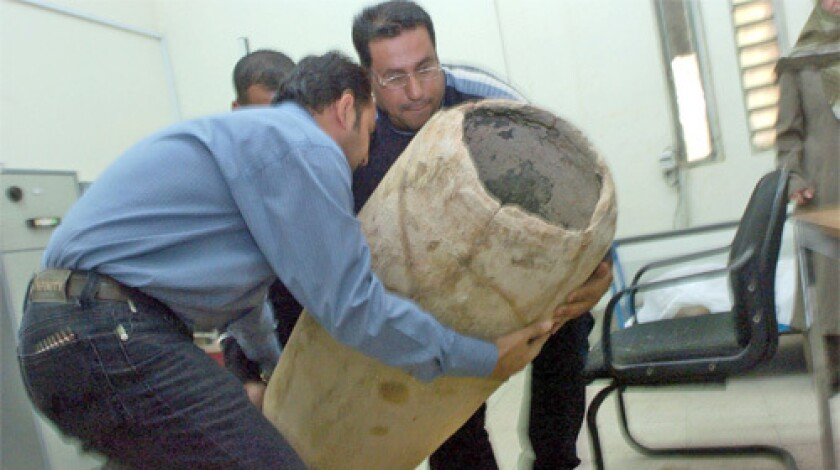 Officials at Iraq's National Museum receive recently recovered artifacts.
