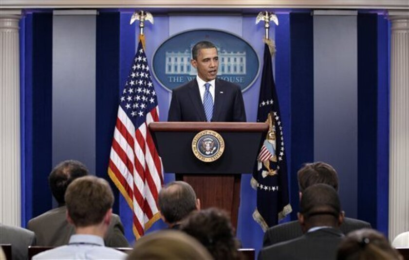 President Barack Obama speaks to the media after a meeting with House Speaker John Boehner, R-Ohio, and Senate Majority Leader Harry Reid, D-Nev., at the White House in Washington, regarding the budget and possible government shutdown, Thursday, April 7, 2011. (AP Photo/Carolyn Kaster)