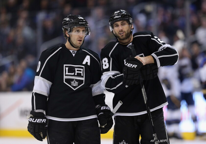 Former Kings Mike Richards (10) and Jarret Stoll (28) talk during a 2013 game against the Blues.
