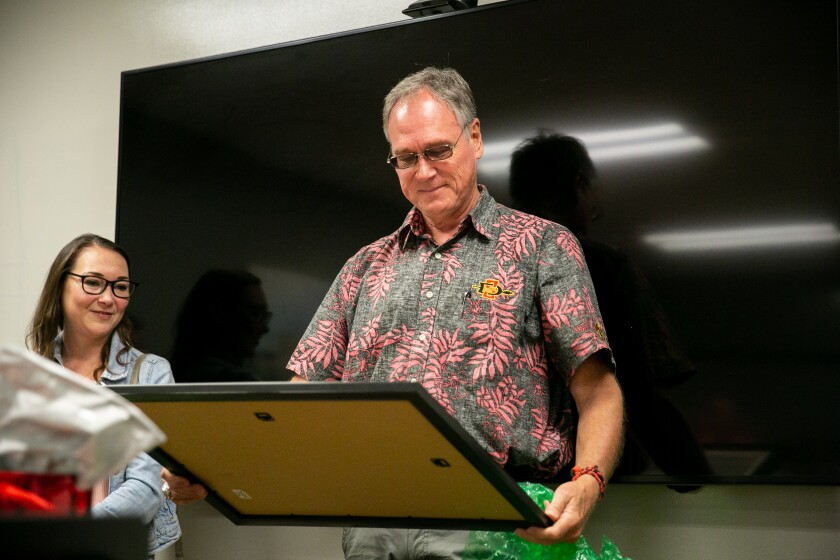 Jack Ulmer, a San Diego State University fan and alum whose home burned down in the Camp Fire, received gifts of new memorabilia at the Aztec Alumni Center. Among the gifts were an Mountain West championship ring, signed hats from Aztecs football coach Rocky Long and Ulmer's diploma, which was lost along with other Aztecs memorabilia in the blaze.
