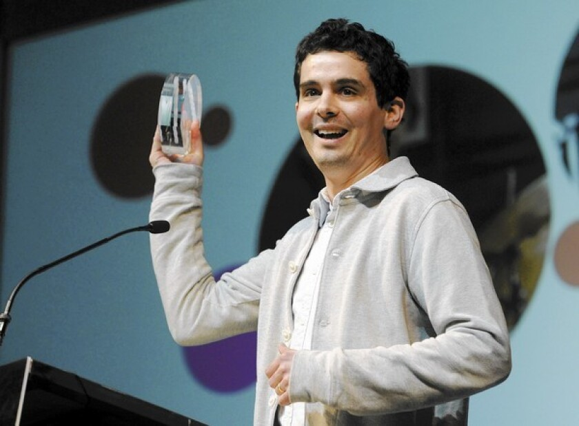 """Damien Chazelle, director of """"Whiplash,"""" accepts the Grand Jury Prize: Dramatic award for his film at the Sundance Film Festival."""