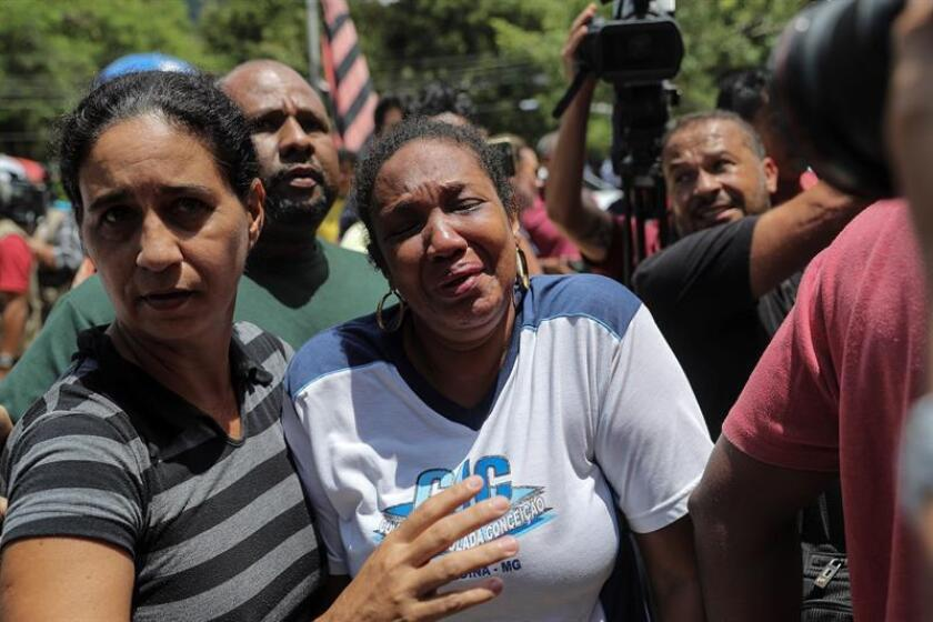 Distressed families of young soccer players gather outside the Flamengo sports facilities seeking news of their loved ones, of whom at least 10 were killed in the blaze that destroyed the youth lodging center and 3 were injured. EFE-EPA/Antonio Lacerda