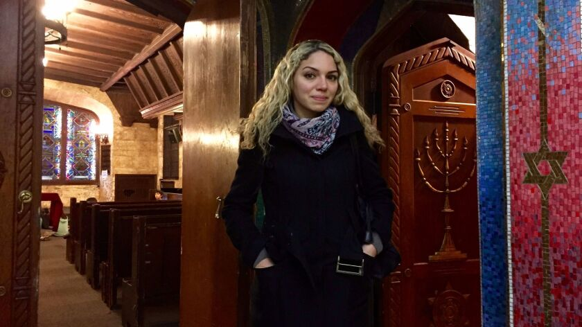 Ahed Festuk, a Syrian refugee, stands inside B'nai Jeshurun synagogue on New York's Upper West Side. She studies English in a free program housed in the synagogue's basement.