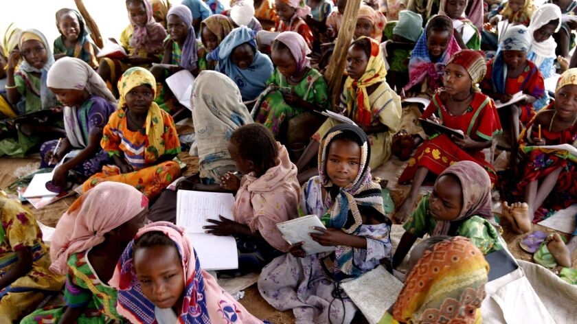 Darfur refugees attend an outdoor primary school run by Christian Organization for Relief and Develo