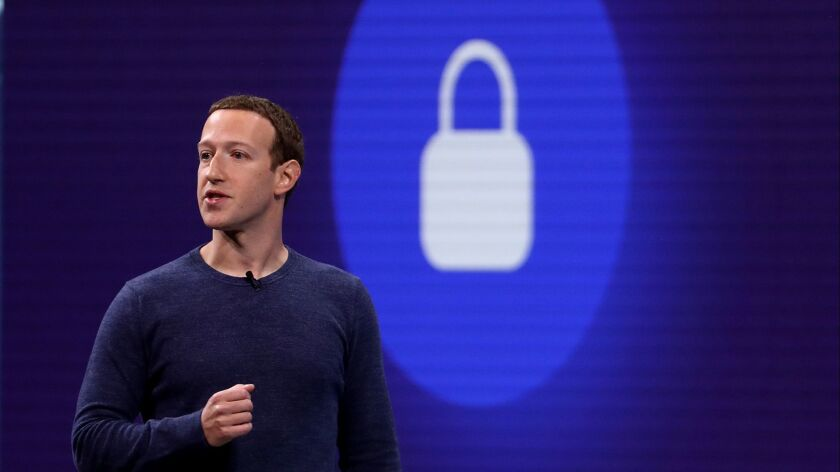 Facebook Chief Executive Mark Zuckerberg delivers a speech at a developers conference in 2018.