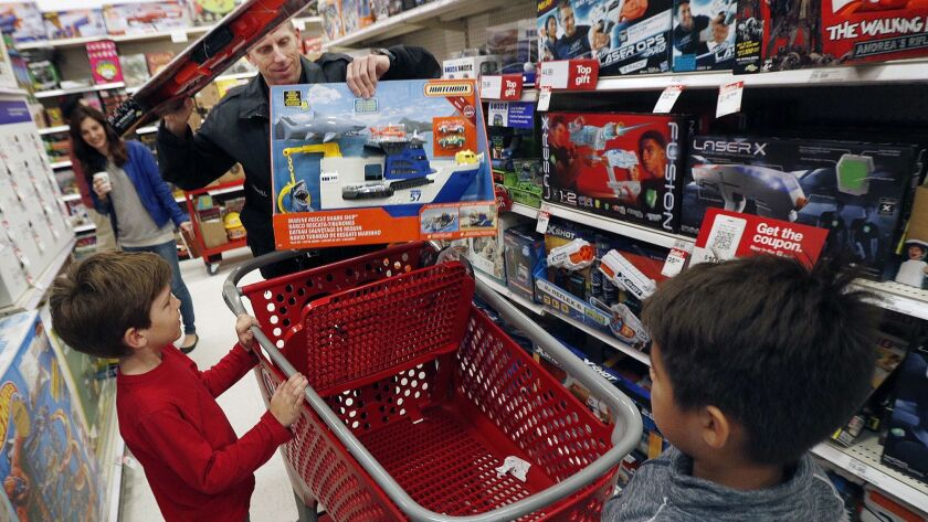 Detective Harry Terrill, starts to evaluate the prices of the toys in his cart placed by the childre