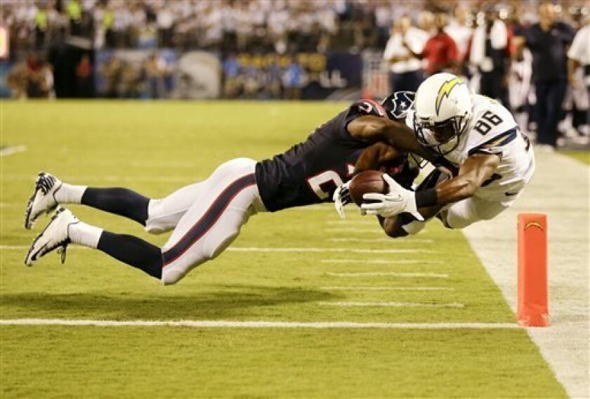 San Diego Chargers wide receiver Vincent Brown, right, scores past Houston Texans cornerback Johnathan Joseph during the first half of an NFL football game Monday, Sept. 9, 2013, in San Diego. (AP Photo/Gregory Bull)