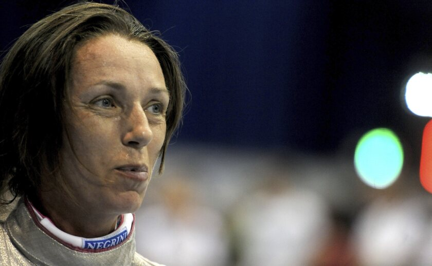 FILE - In this Aug. 5, 2013 file photo, Valentina Vezzali of Italy smiles during the women's individual foil qualifying rounds at the Fencing World Championships in Budapest, Hungary. Six-time Olympic fencing champion Valentina Vezzali was named the Italian government's cabinet undersecretary in charge of sports on Friday. The 47-year-old Vezzali will be in charge of relations with the Italian Olympic Committee (CONI) and also oversee amateur sports across the country. (AP Photo/MTI, Imre Foldi)