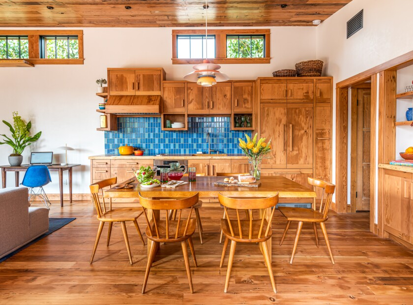 Wood cabinets, ceiling, floor and window trim in a kitchen/dining room