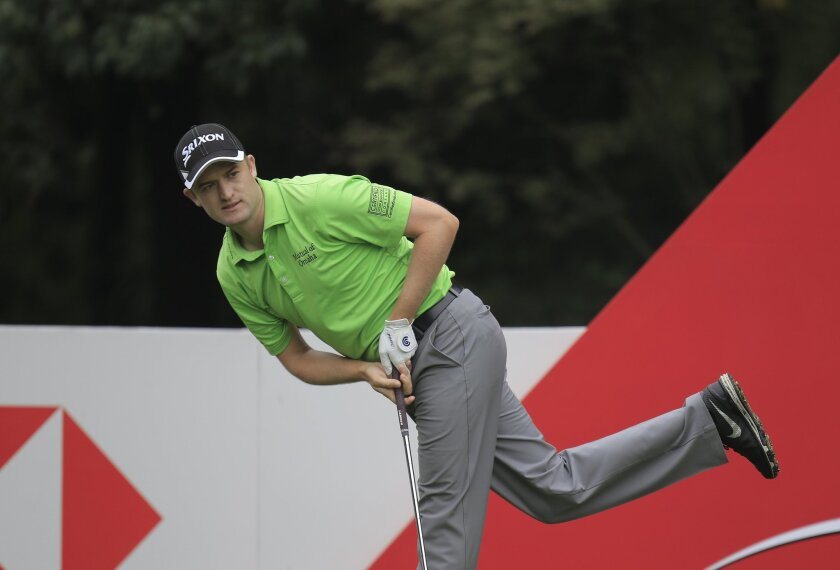 Russell Knox of Scotland looks at his shot on the 6th hole during the third round of the HSBC Champions golf tournament at the Sheshan International Golf Club in Shanghai, China Saturday, Nov. 7, 2015. (AP Photo)