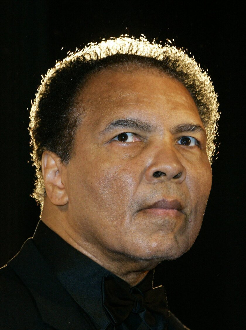 FILE - In this Dec. 17, 2005, file photo, boxing legend Muhammad Ali poses in Berlin, Germany.  Ali, the magnificent heavyweight champion whose fast fists and irrepressible personality transcended sports and captivated the world, has died according to a statement released by his family Friday, June
