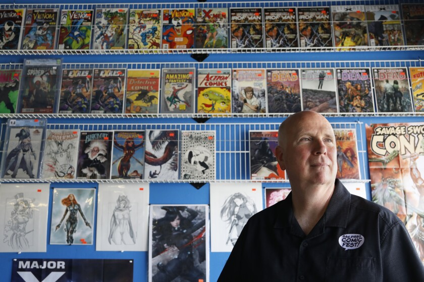 Pictured at a Kearny Mesa comics store, Mike Towry, a co-founder of Comic-Con, has attended most of the San Diego conventions.