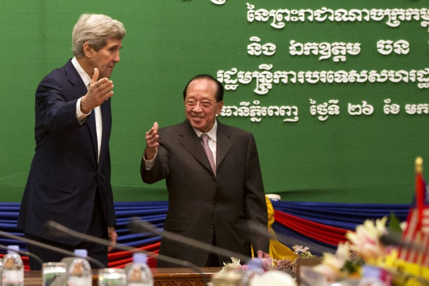 U.S. Secretary of State John Kerry, left, meets with Cambodia's Foreign Minister Hor Namhong at the Ministry of Foreign Affairs in Phnom Penh, Cambodia, Tuesday, Jan. 26, 2016. Kerry is in Cambodia on the fourth leg of his latest round-the-world diplomatic mission, which will also take him to China. (AP Photo/Jacquelyn Martin, Pool)