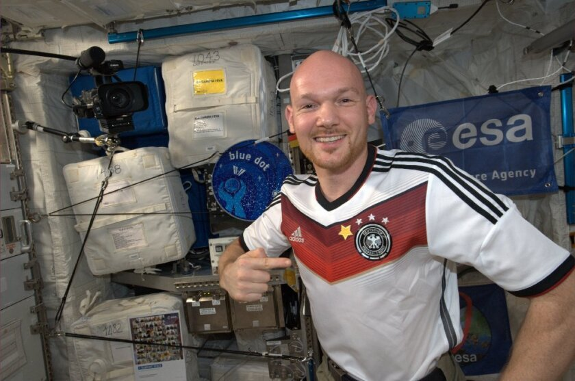 Astronaut Alexander Gerst aboard the International Space Station. He added a fourth star to his German soccer shirt after the country's team won the FIFA World Cup this month.