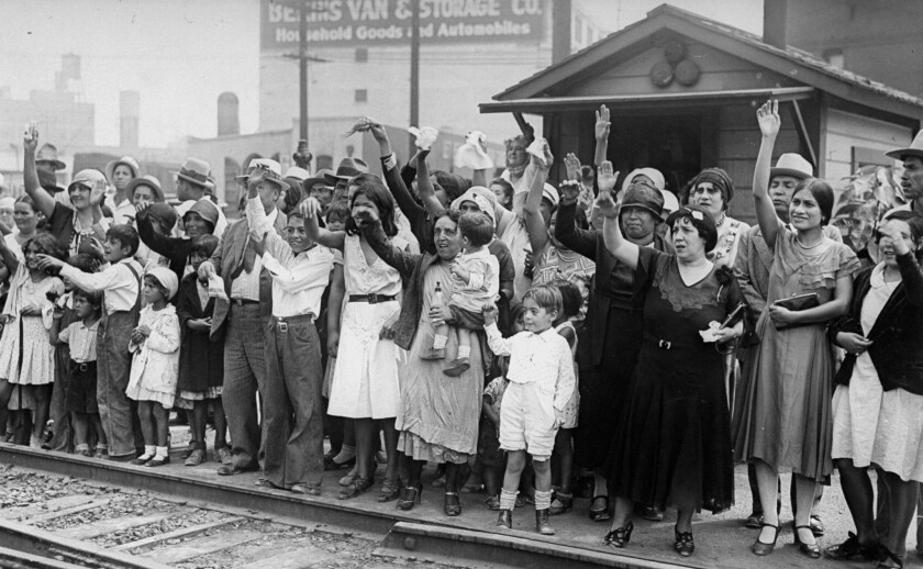 Relatives and friends wave goodbye to a train carrying 1,500 Mexicans expelled from L.A.