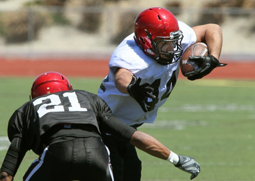 #21 Mahbu Keels, of Mission Bay High School, zeroes in on tight end Adam Roberts.