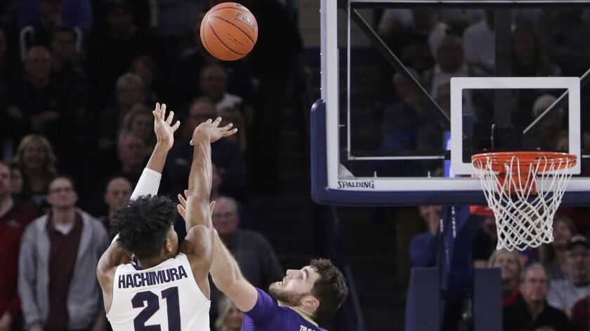 Gonzaga forward Rui Hachimura (21) shoots the go-ahead basket while defended by Washington forward S