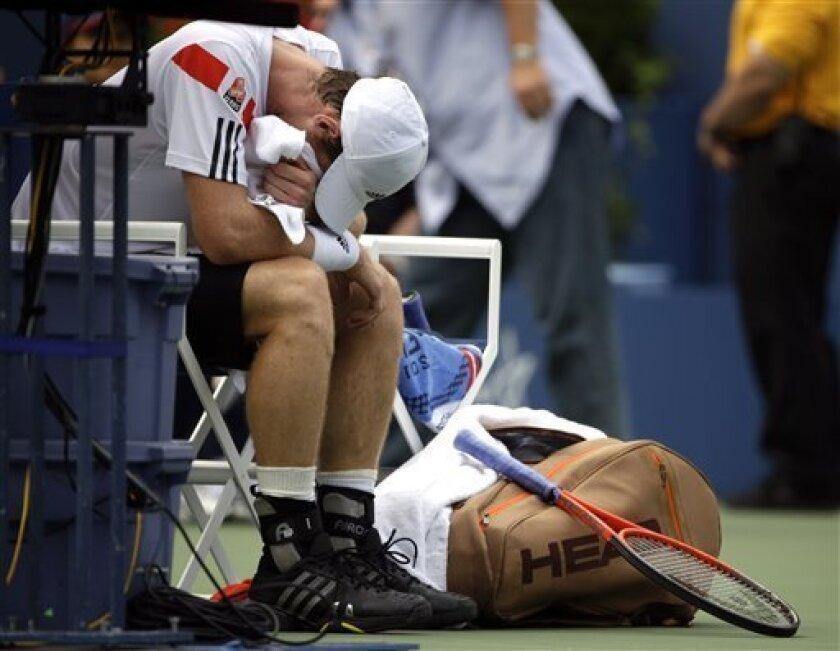 Andy Murray, of Great Britain, buries his face in his towel during a break between games against Florian Mayer, of Germany, during the third round of the 2013 U.S. Open tennis tournament, Sunday, Sept. 1, 2013, in New York. (AP Photo/David Goldman)