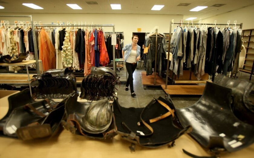 """The L.A. Opera's costume shop, pictured in 2013 during the tailoring of outfits for """"The Magic Flute,"""" is moving -- so an estimated 1,000 costumes are being put up for sale."""