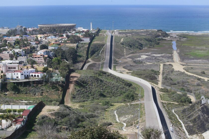 The view west from the San Ysidro Point of Entry shows the border fence that runs to the Pacific dividing Mexico (at left) and the United States.