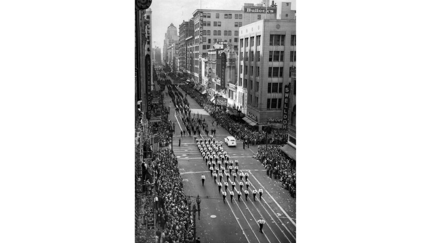 Nov. 11, 1941: New Army units, service organizations and State Guard units march down Broadway at Se