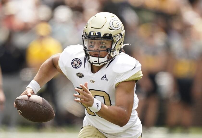 Georgia Tech quarterback Jordan Yates (13) runs the ball against Kennesaw State during the first half of an NCAA college football game, Saturday, Sept. 11, 2021, in Atlanta. (AP Photo/Brynn Anderson)