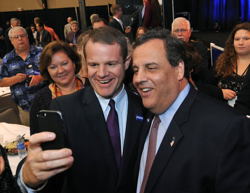 New Jersey Gov. Chris Christie, right, last month in Clive, Iowa, at a birthday party for Iowa Gov. Terry Branstad.
