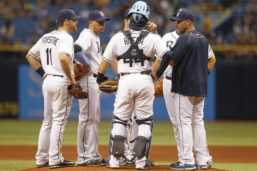 """Tampa Bay Rays meet at the pitchers mound in the sixth inning during the MLB baseball game between the Tampa Bay Rays and Oakland Athletics on Saturday, May 23, 2015 at Tropicana Field in St. Petersburg, Florida. (Eve Edelheit/The Tampa Bay Times via AP) TAMPA OUT; CITRUS COUNTY OUT; PORT CHARLOTTE OUT; BROOKSVILLE HERNANDO TODAY OUT (Honor """"soft outs"""" for USA Today if entered)(REV-SHARE) (ONLN OUT; IONLN OUT - MBI)"""