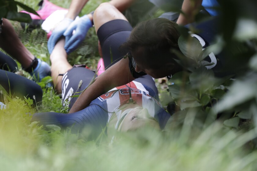 United States' Chloe Dygert gets medical assistance after falling down during the women's Individual Time Trial event, at the road cycling World Championships, in Imola, Italy, Thursday, Sept. 24, 2020. (AP Photo/Andrew Medichini)