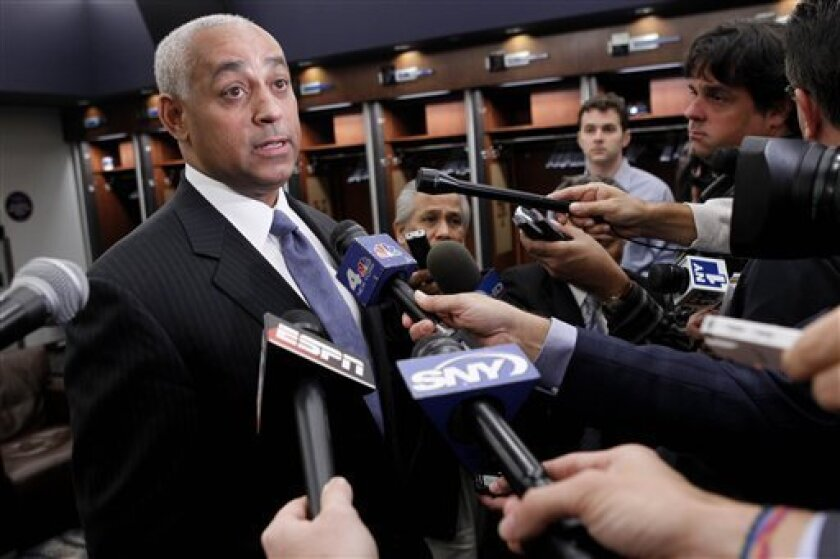 Omar Minaya speaks to the media in the Mets club house Monday, Oct. 4, 2010, at Citi Field in New York. The New York Mets fired manager Jerry Manuel and relieved general manager Omar Minaya of his duties on Monday, an expected shake-up of the big-spending ballclub after it completed its second straight losing season. (AP Photo/Seth Wenig)