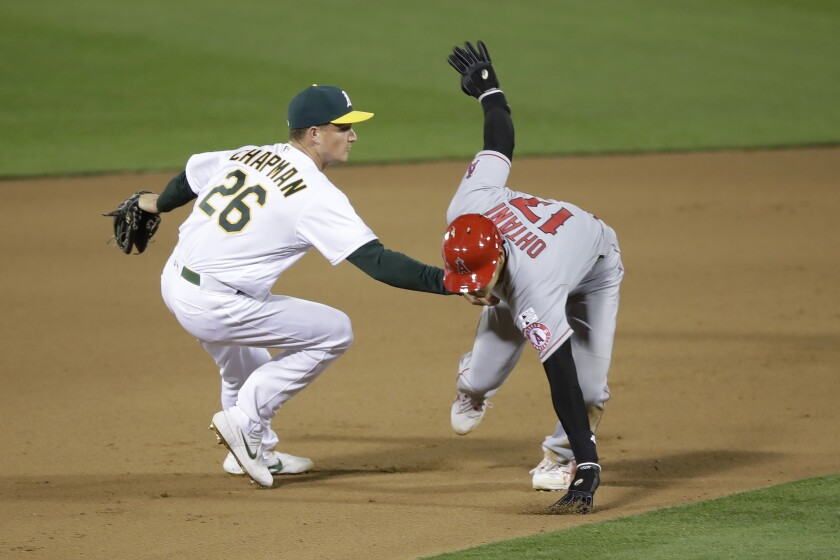 The Athletics' Matt Chapman tags out the Angels' Shohei Ohtani during the 10th inning July 24, 2020.