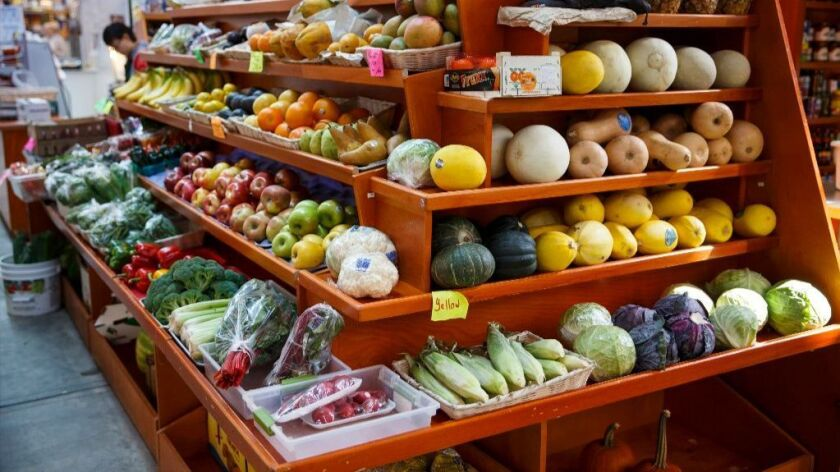 In this April 24, 2014 file photo, a variety of healthy fruits and vegetables are displayed for sale at a market in Washington.