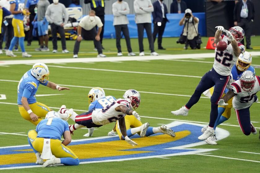 Patriots defensive back Cody Davis (22) blocks a field goal attempt from Chargers kicker Michael Badgley (4).